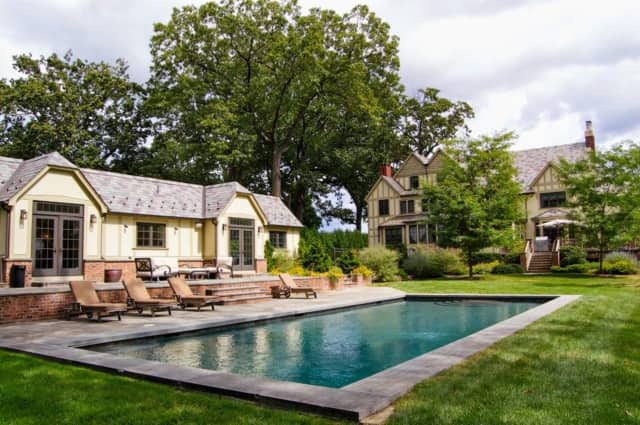 Located on Crest Road, this Ridgewood home boasts a heated pool complete with its own pool house.