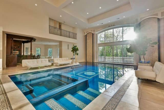 The Saddle River home features an indoor pool and outdoor courts.