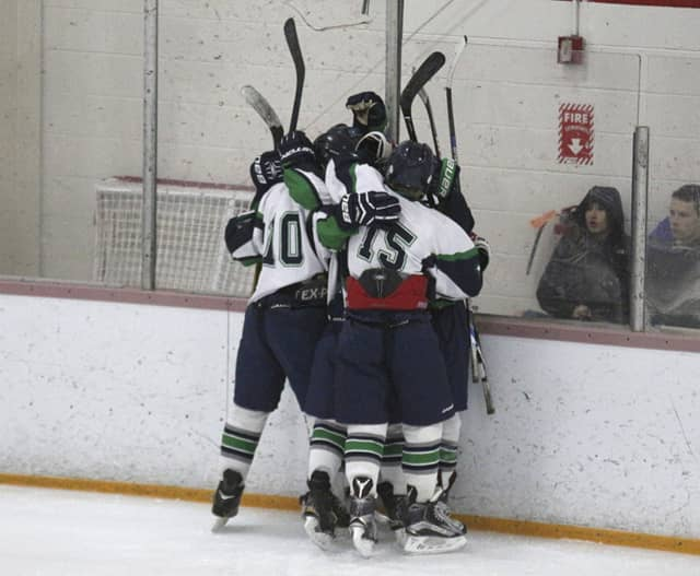 The Ice Cats celebrate one of 11 goals in a win.