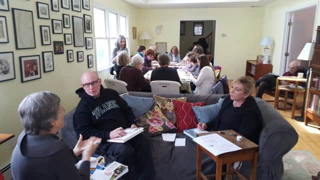 "Members of CD17Indivisible and others participate Sunday in the ""Ides of Trump"" campaign. The goal of the national campaign is to send the White House at least a million postcards expressing concerns about current policies on Wednesday, March 15."