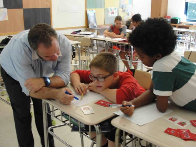 Seventh-graders in Gregg Pernick's math class turn the classroom into a battlefield when they played Integer War, a fun and interactive card game, as part of their studies.