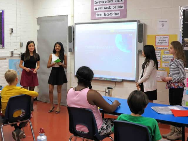 Pierre Van Cortlandt Middle School eighth-graders speak to younger students about Internet safety.
