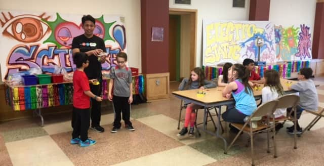 """Third-graders at Dows Lane Elementary School conducted a series of experiments that demonstrated the principles of light, electricity, human eye and microbiology during a four-part """"Mad Month of Science"""" learning unit in March."""