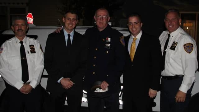 Irvington Police recently congratulated Sgt. Edmund Vize, center, for his promotion and welcomed officers Paul Robibero, second from left, and Angelo Liberatore, second from right. At left, is Chief Michael Cerone; at right, is Lt. Michael Morano.