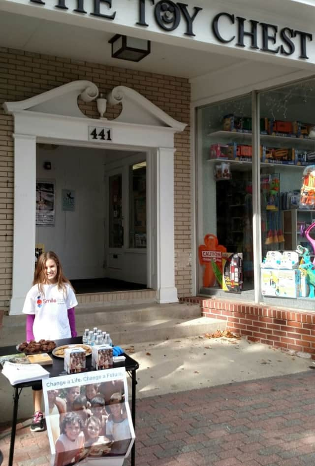 Isabel Christofor outside the Toy Chest to promote the Mile for a Smile walk in Ridgefield.