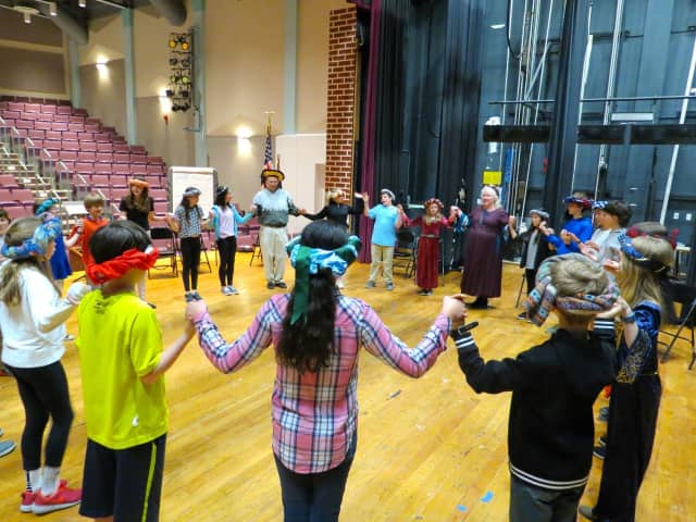 Sixth-graders at John Jay Middle School participate in medieval dancing.
