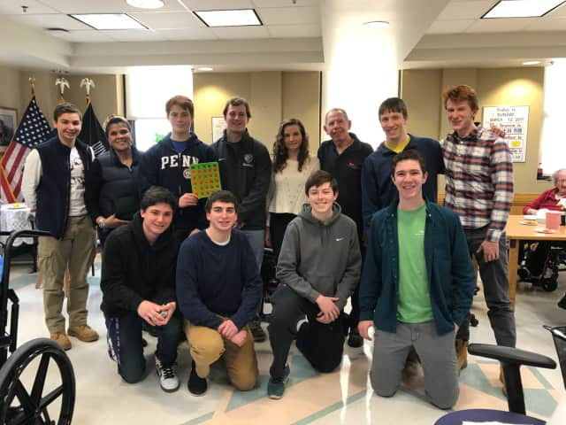 Members of John Jay High School's JJ for Vets club pose for a photo with Kenneth C. Klotzkin, a retired Air Force colonel.