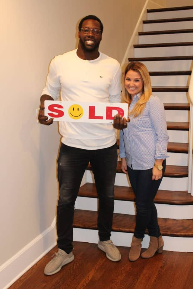 Jason Pierre-Paul and real estate agent Juliana Sullivan in the athlete's new Wyckoff home.