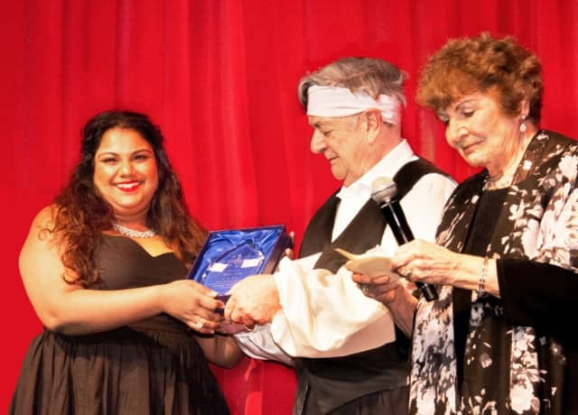 Third place winner (left) Janani Sridhar and first place winner, Sol Jin (far right), receive their awards in the New Jersey Association of Verismo Opera's 27th Annual International Vocal Competition.