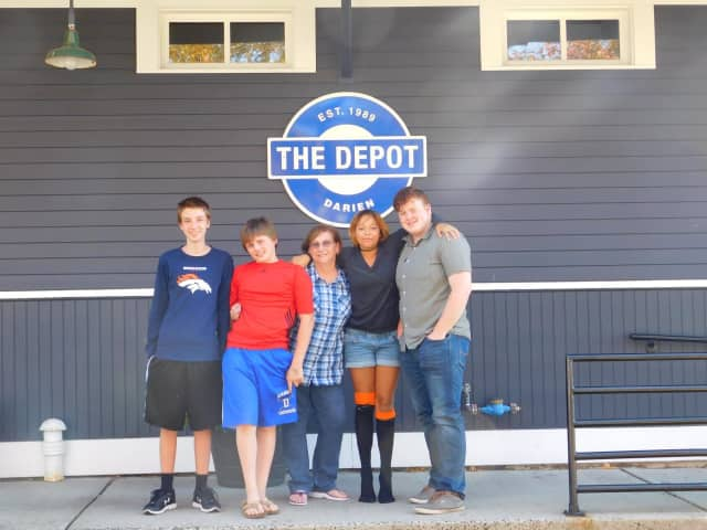 Janice Marzano, middle, with teens at the Depot.