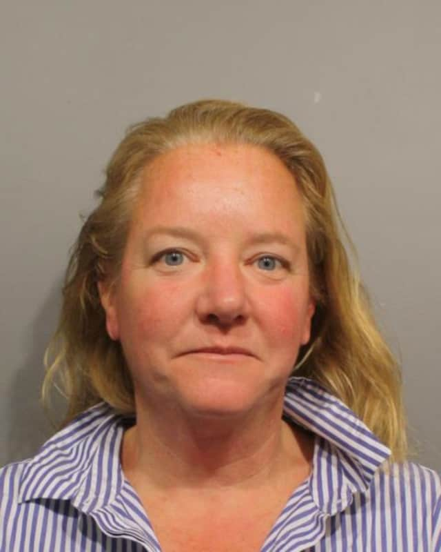 Jeanne Tienken, of Belmont, Mass., turned herself in to Wilton police in December after learning of a warrant for her arrest on charges of harassment and violating a restraining order.