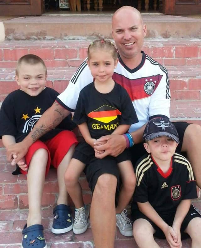 Jeff Leider of Elmwood Park poses with his children Jason, Jordan and Justin.
