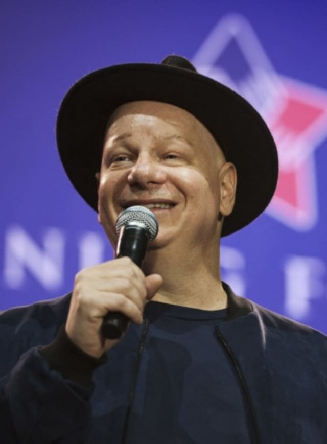 Jeff Ross, comedian, performs a comedy skit during the 'Celebration of Service' comedy show on Joint Base Andrews, Maryland on May 5, 2016.