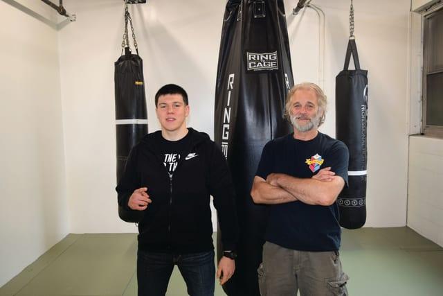 Jesse James Kosakowski and his father, Ron Kosakowski, at Ron's Practical Self Defense Training Center in Waterbury.
