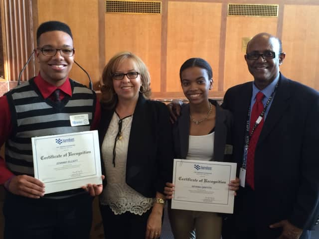 Jovanny Elliot and Keyana Griffith holding their certificates of recognition with PHS college resource advisor Maria Gordineer and assistant principal Kent Picou at an award ceremony in White Plains.