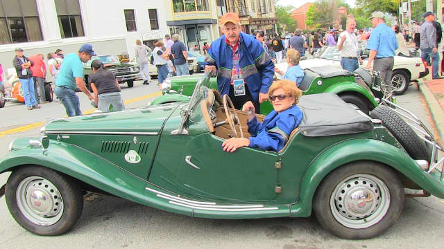 Judith Johnson in her prize-winning 1955 MG TF1500 2-door convertible.