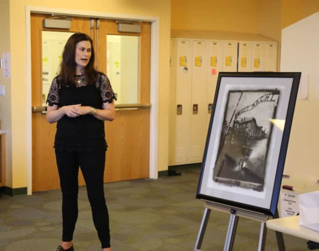 Julia Gilbert of Greenwich displayed her father's photography of Auschwitz and other concentration camps during her recent presentation on the Holocaust at Sacred Heart in Greenwich.