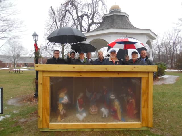 The Creche on the Monroe Town Green is protected from the rain Dec. 18 for a blessing. Rainy weather is expected on Christmas Eve but the system will be gone by nightfall in Fairfield County.