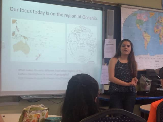 Hastings High School student Kaitlin Penner teaching a geography lesson in social studies teach Barbara Richman's class.