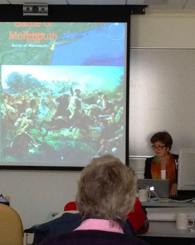 Kathleen Tesluk gives a talk on the Revolutionary War.