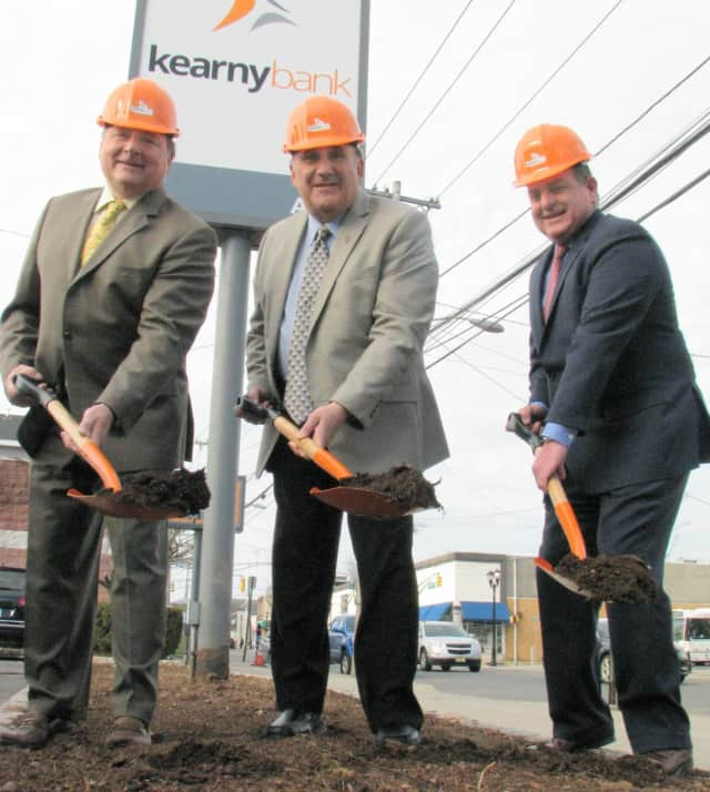 From left to right: John Mazur, Mayor Joseph Bianchi, and Craig Montanaro break ground at Kearny Bank's North Arlington branch.