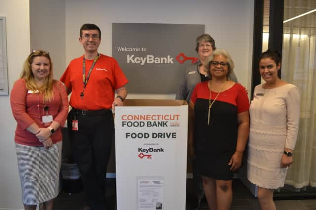 Employees at the KeyBank New Haven Branch prepare for the Connecticut Food Bank food drive.
