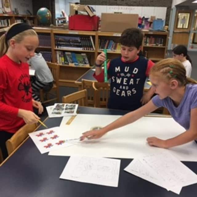 "West Patent Elementary School students, pictured during their recent ""Kiit"" initiative to make packages."