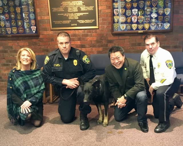 State Rep. Brenda Kupchick (R-132), Fairfield Police Officer Kevin Wells with K9 Officer Jagger, Fairfield Police Chief Gary MacNamara and Sen. Tony Hwang (R-28). The legislators support a bill to enhance criminal penalties to protect police dogs.