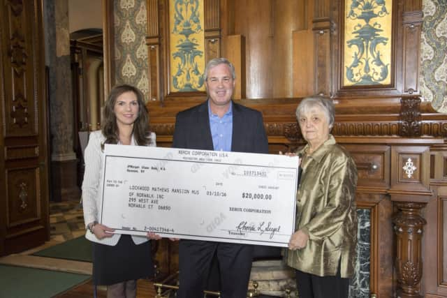Lockwood-Mathews Mansion Museum Executive Director Susan Gilgore, The Xerox Foundation President Mark Conlin and Patsy Brescia, chairman of the museum's board of trustees .