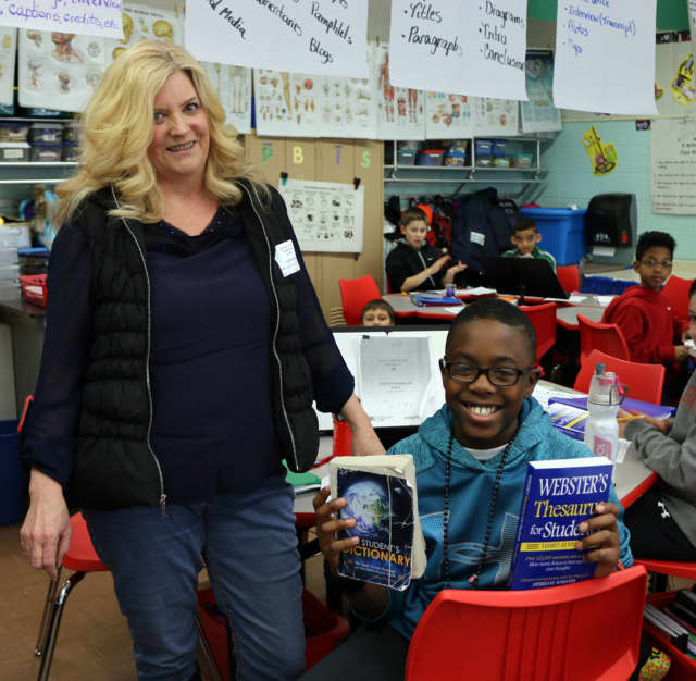 Students at Lakleand received dictionaries and thesauruses from the Cortlandt rotary club