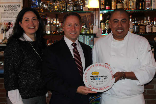 Celebrating Restaurant Week in Irvington, are from left: Natasha Caputo, director of Westchester County Office of Tourism and Film, Westchester County Executive Rob Astorino and Juan Aguilar, owner of La Chinita Poblana.