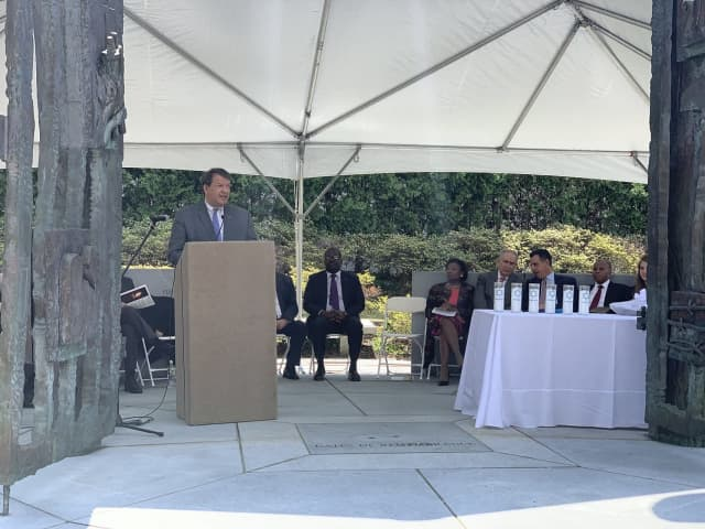 Westchester County Executive George Latimer speaks at the Garden of Remembrance in White Plains.