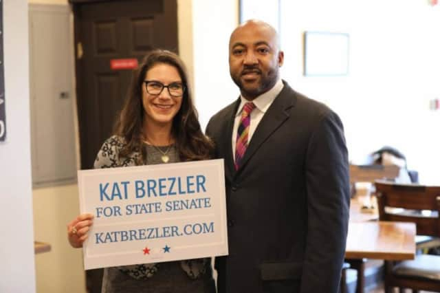Kat Brezler stands with New Rochelle Councilman Jared Rice following the announcement of her candidacy for State Senate.