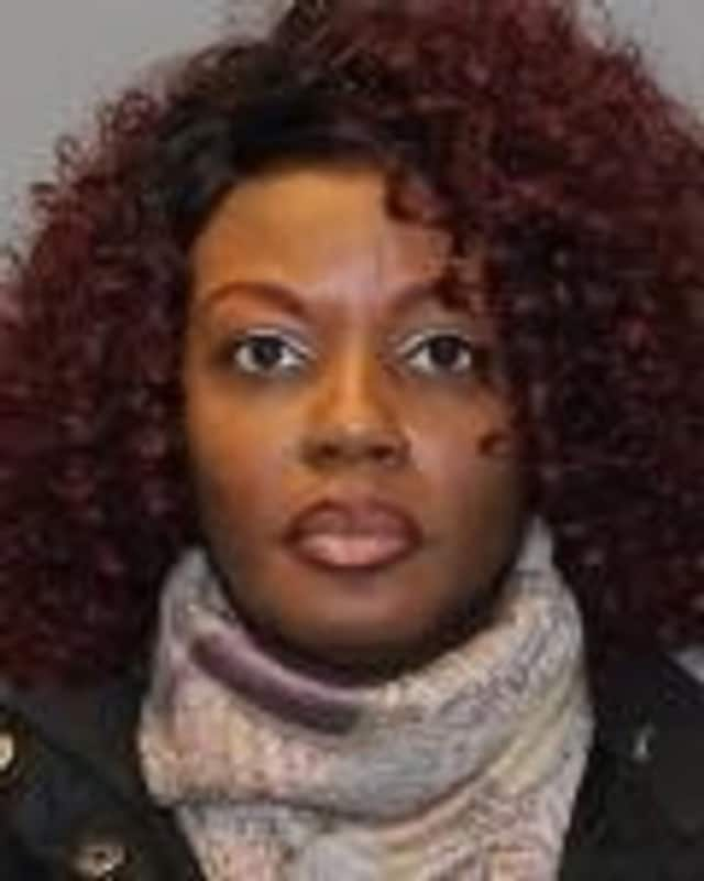 Laverne R. Lane, a Long Island resident, was arrested at Sing Sing in Ossining Thursday, Jan. 14, and charged with promoting prison contraband and possession of an illegal substance.