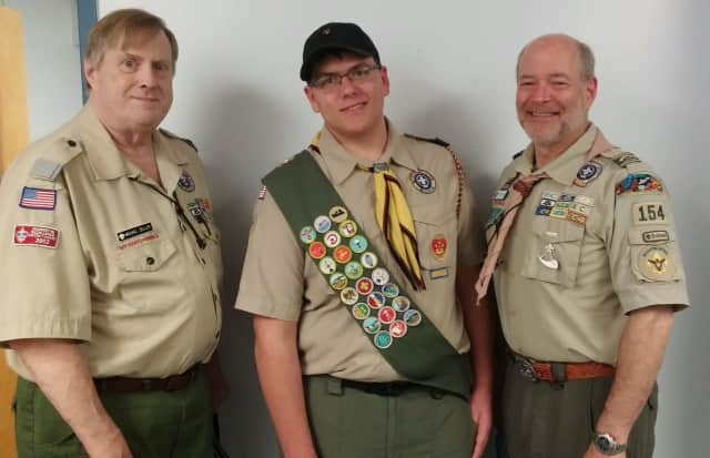 John Jay High School senior Clayton Leibig, center, earns his Eagle Scout award.