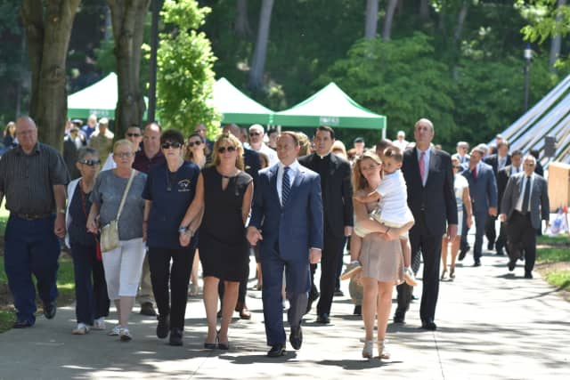 Westchester County Executive Rob Astorino and members of the Lemm family lead a procession during a ceremony at Kensico Dam.
