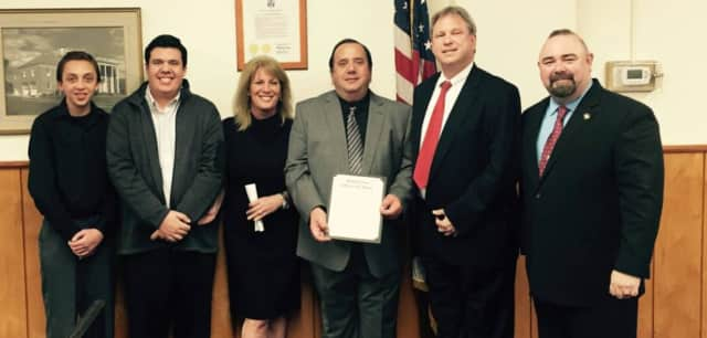 Len Fabiano (center) was honored with a proclamation from Emerson Mayor Lou Lamatina.