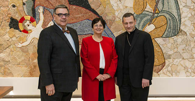 From left are Sacred Heart University President John Petillo, Catholic Studies Chair Michelle Loris and Bishop Frank Caggiano in the Chapel of the Nativity.