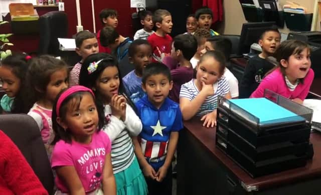 Kindergartners from Lincoln sang their school song at the Bergenfield Police Department.