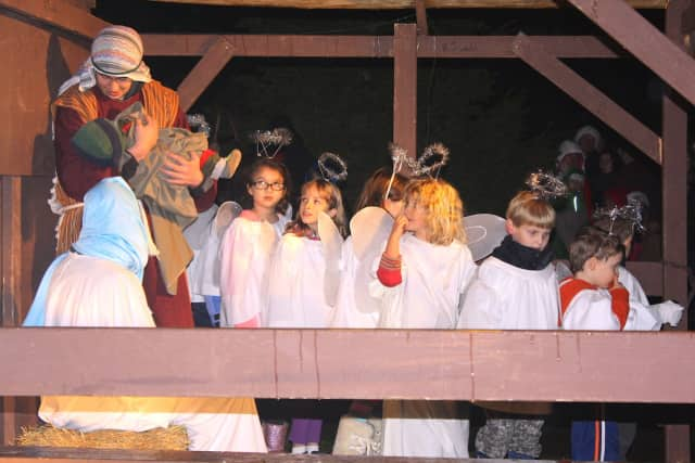 """During last year's """"Living Nativity"""" presented by Jesse Lee Memorial United Methodist Church, Joseph (Eric Dollins) comforts the baby Jesus while surrounded by Mary (Victoria Nazworth) and a host of angels."""