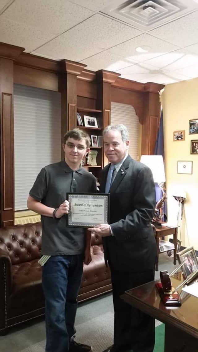 Rockland County Executive Ed Day honors Clarkstown High School North student J.T. Mancino for his winning design submission to the Rockland County Traffic Safety Board.