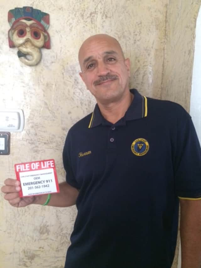 Hernan Lopez with the File of Life card he created.