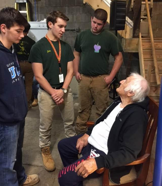 Veteran Lou Russo, 97, talks with Abbott Tech students who installed a new heating system in his house in New Fairfield.