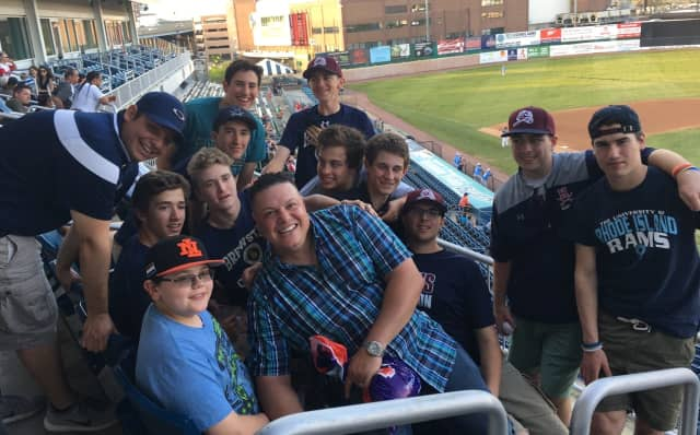 Luis Lopez with his baseball players at a Bluefish game.