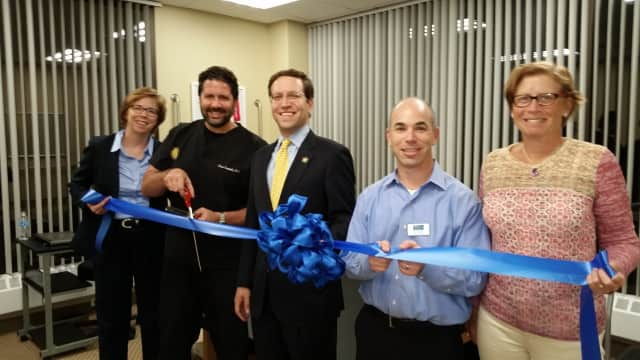Mount Kisco Medical & Injury Care ribbon cutting. Shown left to right are Dr. Louis Campbell, New York State Assemblyman David Buchwald (D-White Plains) and Mt. Kisco Chamber President Dan Taplitz