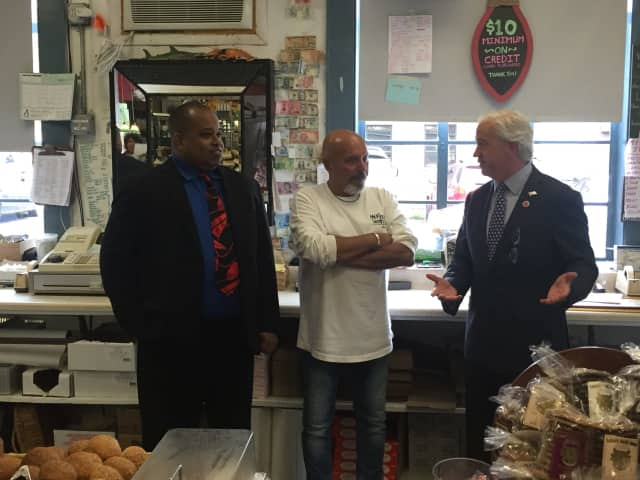 Joe DiMauro (c), owner of Mount Kisco Seafood with County Legislator Francis Corcoran (l) and Michael Jefferson. (r)