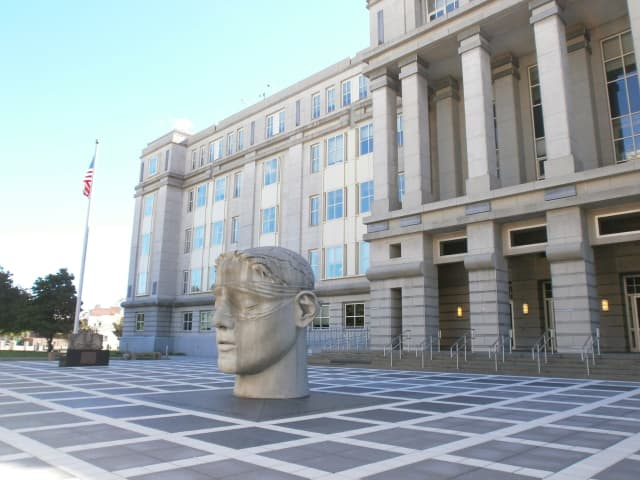 Two Jersey City men face charges of trafficking heroin and fentanyl, causing the overdose of a prison inmate.