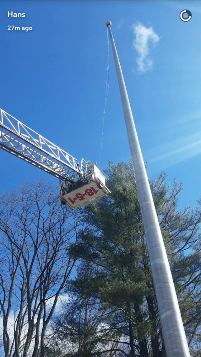 Members of the Mahopac FD helped Mahopac Middle School custodians replace a flag pole cable Friday morning.