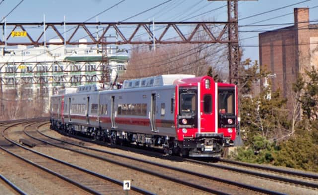 A Metro-North Railroad train heads for Connecticut on the  New Haven Line.