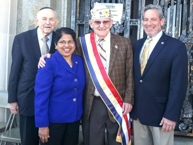 Rockland County legislators Phil Soskin, Aney Paul and Michael Grant honor World War II veteran Alan Moskin of Nanuet.